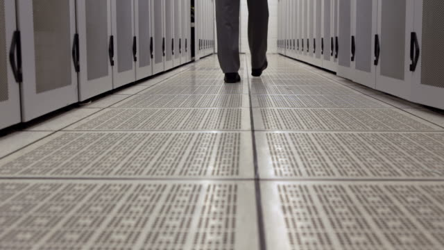 Data technician walking through locker hall video