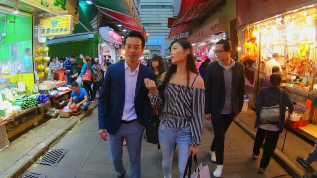 dating couple shopping in hong kong - affluent lifestyles stock videos & royalty-free footage