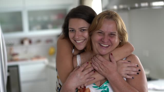 Daughter and Mother Embracing at Home Brazilian Family mothers day stock videos & royalty-free footage