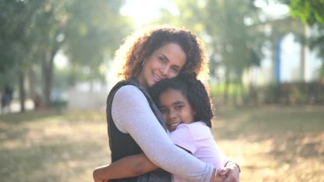 Daughter and Mother Embracing