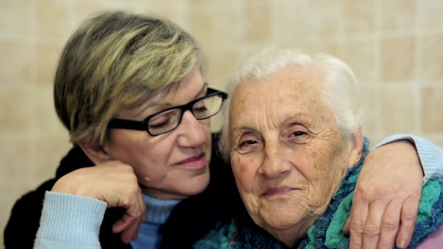 daughter embrace her mother: old, ancient, aged, alone, two, women video