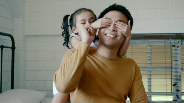 daughter playing with her father - two students together asian video stock e b–roll