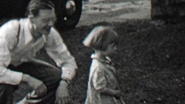 1938: Daughter politely refuses dad camera position grabbing. video