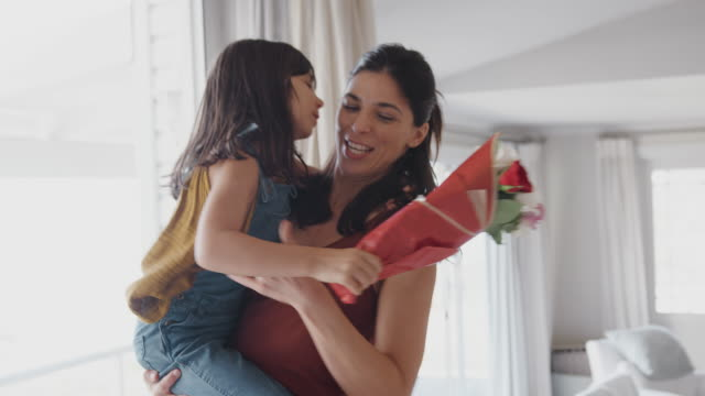 Daughter Running To Mother And Handing Her Bunch Of Flowers To Celebrate Birthday Or Mothers Day Daughter running towards mother at home and handing her a bunch of flowers to celebrate birthday or mothers day - shot in slow motion mothers day stock videos & royalty-free footage