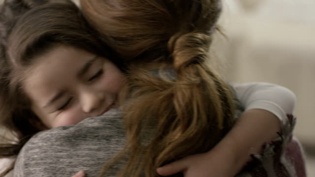 Daughter rushes into mother's arms at home and gives her a big hug. Shot on RED EPIC Cinema Camera in slow motion. Daughter rushes into mother's arms at home and gives her a big hug. Shot on RED EPIC Cinema Camera in slow motion. hug stock videos & royalty-free footage