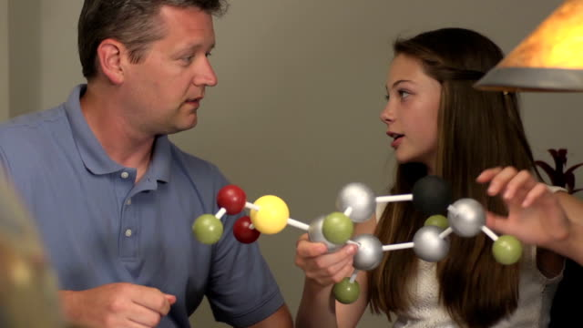 Daughter Shows Father her Science Project of a Molecule video