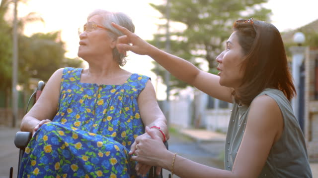 Daughter take care elderly mother on wheelchair,Slow motion Daughter take care elderly mother on wheelchair,Slow motion body care stock videos & royalty-free footage