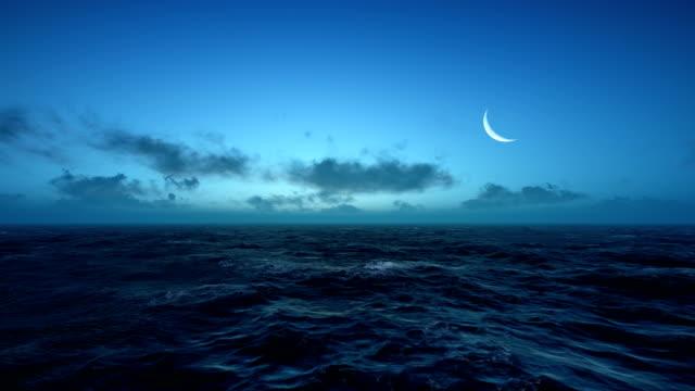 dawn at sea - полумесяц форма предмета стоковые видео и кадры b-roll