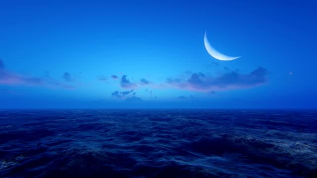 gryning vid havet - halvmåne form bildbanksvideor och videomaterial från bakom kulisserna