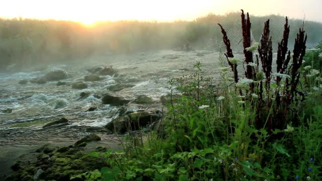 dawn über rushing river - rohrblattinstrument stock-videos und b-roll-filmmaterial