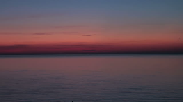 Dawn, Sunrise over the sea; time lapse skyscape video
