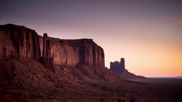 dawn to day in monument valley - time lapse - rock formations stock videos & royalty-free footage