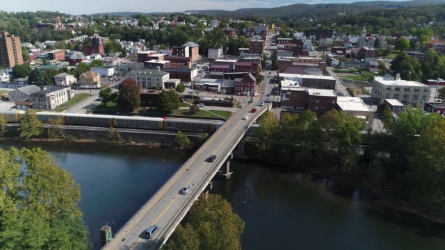 Day Aerial Establishing Shot of Connellsville Pennsylvania A slowly moving forward aerial shot of the small town of Connellsville, Pennsylvania while traffic travels on the Officer McCray Rob Memorial Bridge over the Youghiogheny River. Pittsburgh suburbs. americana stock videos & royalty-free footage