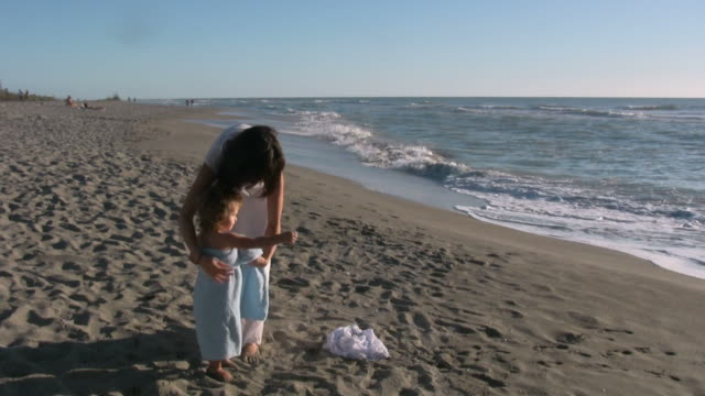 Day At The Beach Mother and daughter at the beach.  wearing a towel stock videos & royalty-free footage