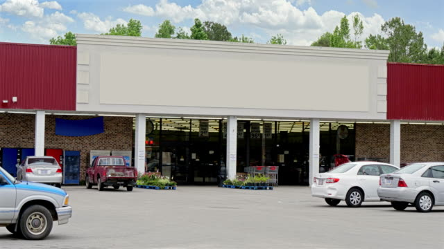 Day Establishing Shot of Generic Unbranded Grocery Store A daytime exterior DX establishing shot of an unbranded, generic grocery store. Blank marquee for customization. facade stock videos & royalty-free footage