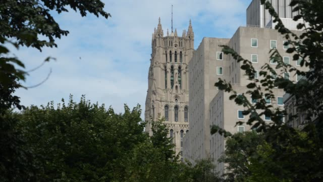 Day Establishing Shot of The Riverside Church in Upper Manhattan A daytime establishing shot of the tower on The Riverside Church in upper Manhattan. church architecture stock videos & royalty-free footage