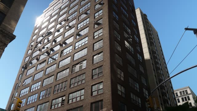 Day Establishing Shot of Typical Brick Building in Manhattan A daytime low angle exterior establishing shot of a typical warehouse-style brick building in Manhattan. loft apartment stock videos & royalty-free footage