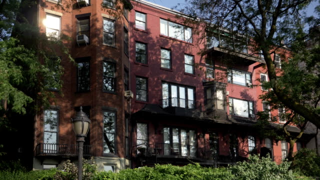 Day Exterior of Upscale Apartment Building in Brooklyn A daytime exterior establishing shot of an upscale apartment building in Brooklyn. flat physical description stock videos & royalty-free footage