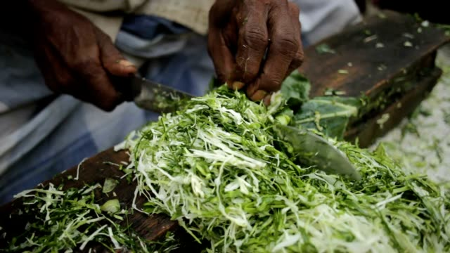 A day in the life of Sri Lanka - man chopping cabbage on the street A day in the life of Sri Lanka - man chopping cabbage on the street - street life colombo stock videos & royalty-free footage