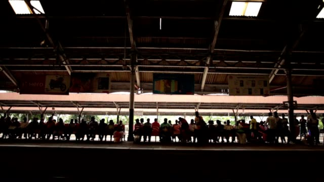 A day in the life of Sri Lanka - train station silhouettes A day in the life of Sri Lanka - train station silhouettes - far enough away to be classes as crowd not requiring a model release colombo stock videos & royalty-free footage