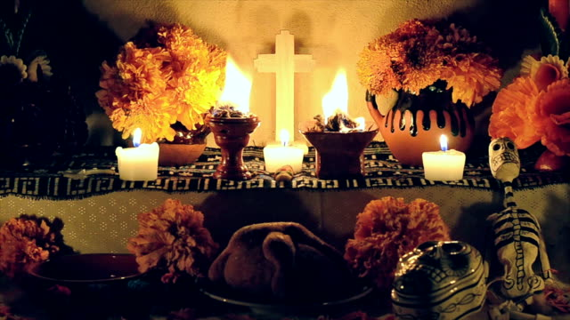 """Day of the dead offering altar Day of the dead offering altar with """"pan de muerto"""", cempasuchil flowers, burning copal and candles. Essential part of Day of the Dead festivities in Mexico. bun bread stock videos & royalty-free footage"""