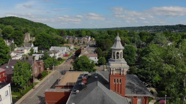 Day Slow Forward Aerial Establishing Shot of Small Town Hall Steeple
