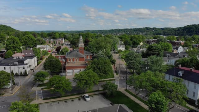 Day Slow Wide Forward Aerial Establishing Shot of Small Town Hall Steeple