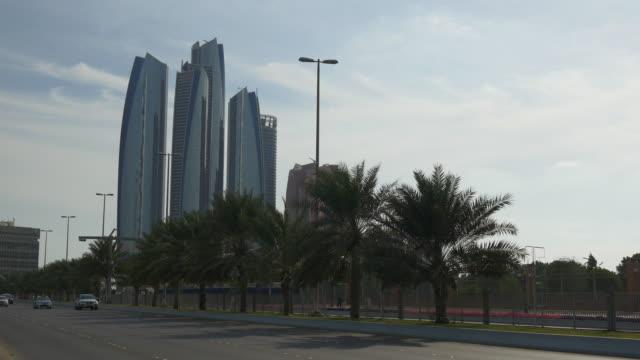day time abu dhabi famous etihad towers bay panorama 4k united arab emirates - uae national day стоковые видео и кадры b-roll