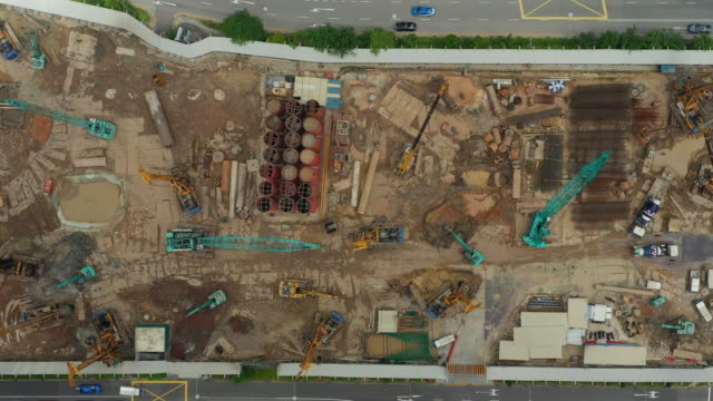 day time flight over singapore city downtown construction yard aerial topdown panorama 4k day time flight over singapore city downtown construction yard aerial topdown panorama 4k singapore architecture stock videos & royalty-free footage