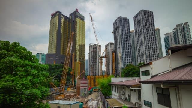 day time kuala lumpur city center downtown construction panorama 4k timelapse malaysia