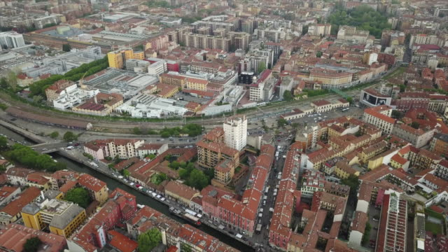day time milan city living block rooftops aerial panorama 4k italy - milan railway video stock e b–roll