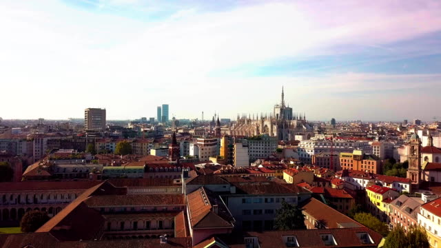 day time milan city living block rooftops traffic street aerial down view fullhd italy - lombardia video stock e b–roll