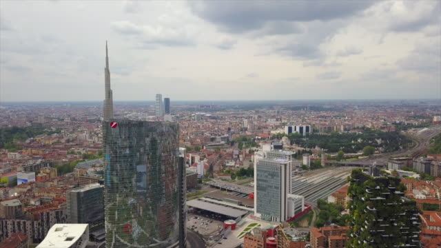day time milan city train station aerial panorama 4k italy - milan railway video stock e b–roll