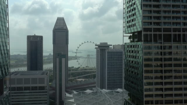 day time singapore city center famous flyer bay aerial panorama 4k