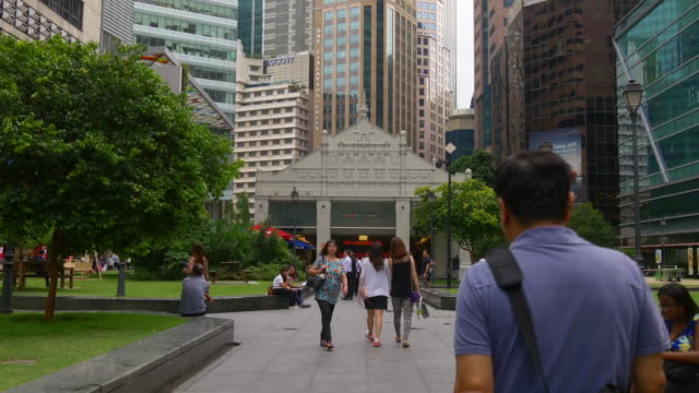 day time singapore downtown raffles place park walking panorama 4k footage - singapore architecture stock videos & royalty-free footage