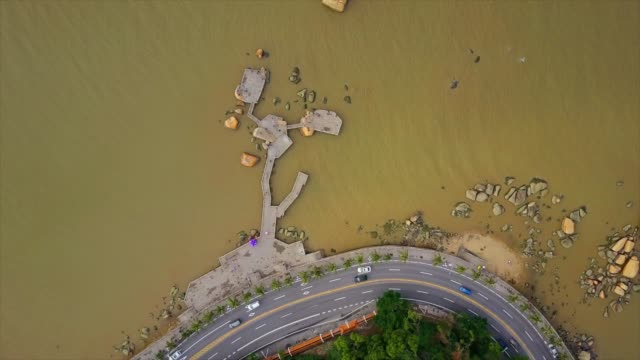 day time zhuhai city famous fisher girl monument bay aerial top view 4k china - zhuhai video stock e b–roll