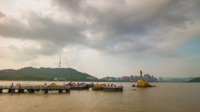 day time zhuhai city famous fisher girl monument crowded pier panorama 4k time lapse china - zhuhai video stock e b–roll