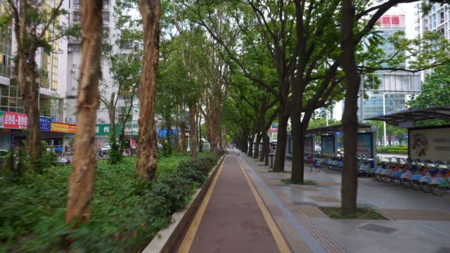 acera de la ciudad de zhuhai día tiempo a china panorama 4k - vídeo