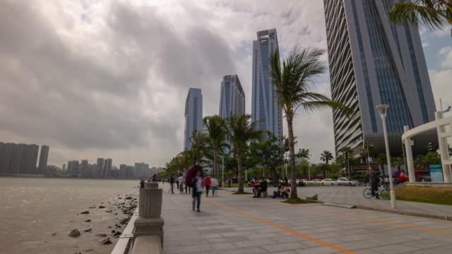 day time zhuhai city tourist crowded promenade bay macau view panorama timelapse 4k china - zhuhai video stock e b–roll