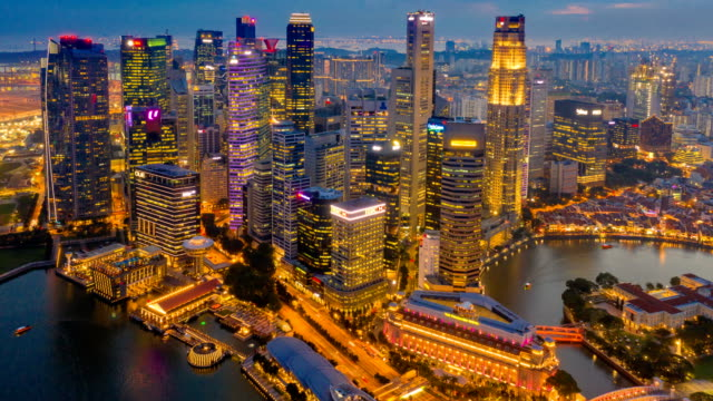 day to night aerial view dronelapse or hyperlapse of financial central business district building of singapore city - time lapse stock videos & royalty-free footage