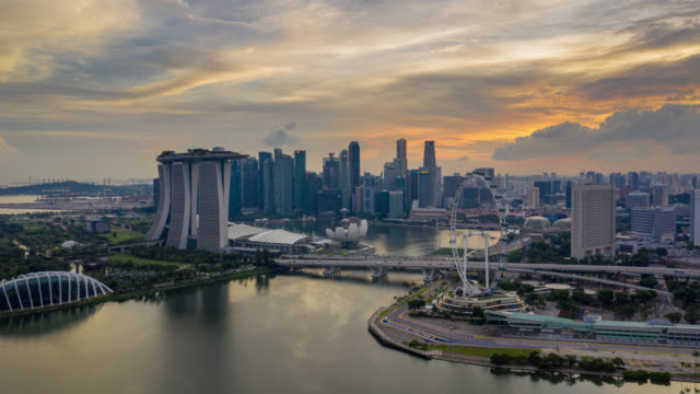 Day to night Hyperlapse or Dronelapse scene of Singapore business district downtown at sunset Day to night Hyperlapse or Dronelapse scene of Singapore business district downtown at sunset singapore architecture stock videos & royalty-free footage