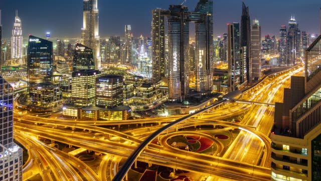 Day to night time lapse at skyline and traffic in Dubai