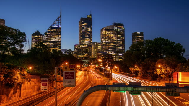 Day to night time lapse in a centric road at Sydney, Australia