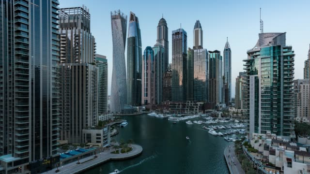 day to night /time lapse modern skycrapers in dubai marina - dubai architecture stock videos & royalty-free footage