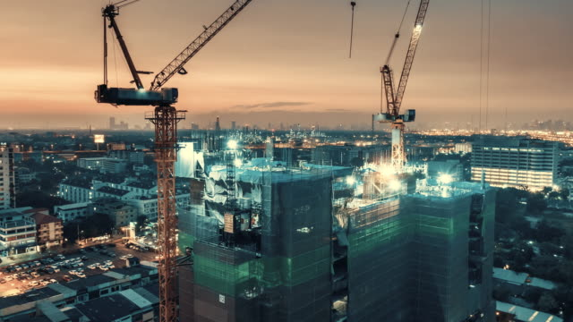 day to night time lapse of construction site - industria edile video stock e b–roll