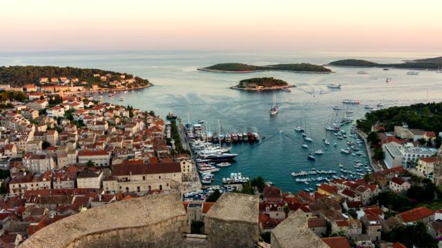 day to night time lapse of hvar town, croatia. - хорватия стоковые видео и кадры b-roll