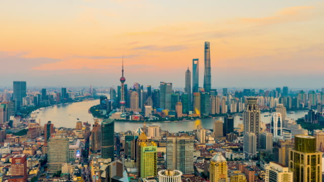 Day to night time lapse of Shanghai skyline and cityscape,China.High Angle view.