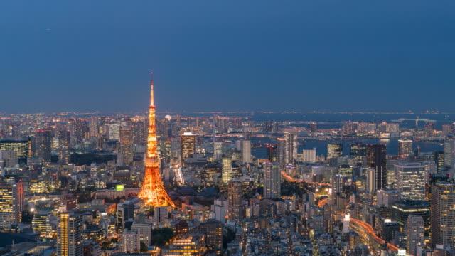 日本の夜の時間経過の東京市に日 - 東京タワー点の映像素材/bロール