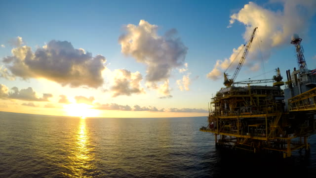 Day to night time lapse offshore with beautiful central processing platform