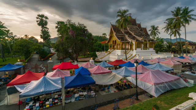 Day to night Timelapse of Night market in front of palace at Luang Prabang in Laos